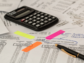 A calculator and financial report from ATA Outsourcing